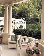 A broad porch wraps around the front of the house, photographed during the administration of Vice President Al Gore.