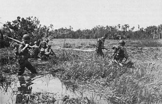 Battle of Leyte - US 1st Cavalry troops wade through a swamp in Leyte