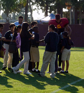 Taylor Mays - Mays signs autographs for school children after a USC practice in fall 2008.