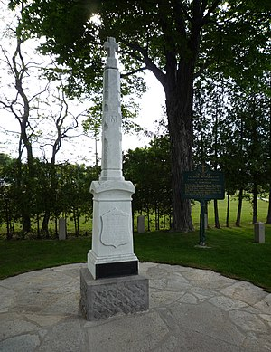 St. Ignace, Michigan - A tombstone marks the grave of Father Marquette, next to the Museum of Ojibway Culture at the former site of St. Ignace Mission.