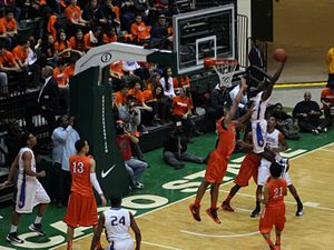 Slam dunk - Image: 20130126 Kendrick Nunn dunks Jabari Parker inbounds alley oop pass over Jahlil Okafor at Simeon Whitney Young game (1)