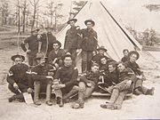 2nd Arkansas Infantry Members in front of a tent