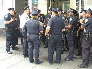 New York City Police Department - A lieutenant (white shirt) debriefing officers at Times Square in May 2010.