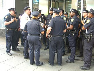 New York City Police Department - Lieutenant debriefing officers at Times Square