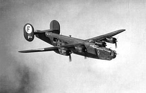 "703d Tactical Air Support Squadron - B-24H Liberator 42-7563, ""Hell's Warrior"" showing the 445th Bombardment Group Circle F tail marking. Aircraft was lost on February 9, 1944"