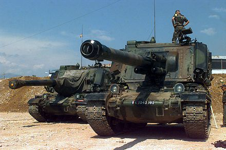 Two French Army Giat GCT 155mm (155 mm AUF1) Self-propelled Guns, 40th Regiment d' Artillerie, with IFOR markings are parked at Hekon base, near Mostar, Bosnia-Herzegovina, in support of Operation Joint Endeavor. AMX AuF1, 40e régiment d'artillerie, Implementation Force, 1996.jpg