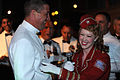 A Sailor shares a laugh with a member of the Victory Belles at the D-Day Museum in New Orleans..jpg