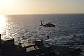 A U.S. Navy MH-60S Seahawk helicopter assigned to Helicopter Sea Combat Squadron (HSC) 22 lifts cargo from the flight deck of the fast combat support ship USNS Arctic (T-AOE 8) during a replenishment at sea with 140101-N-CC806-095.jpg