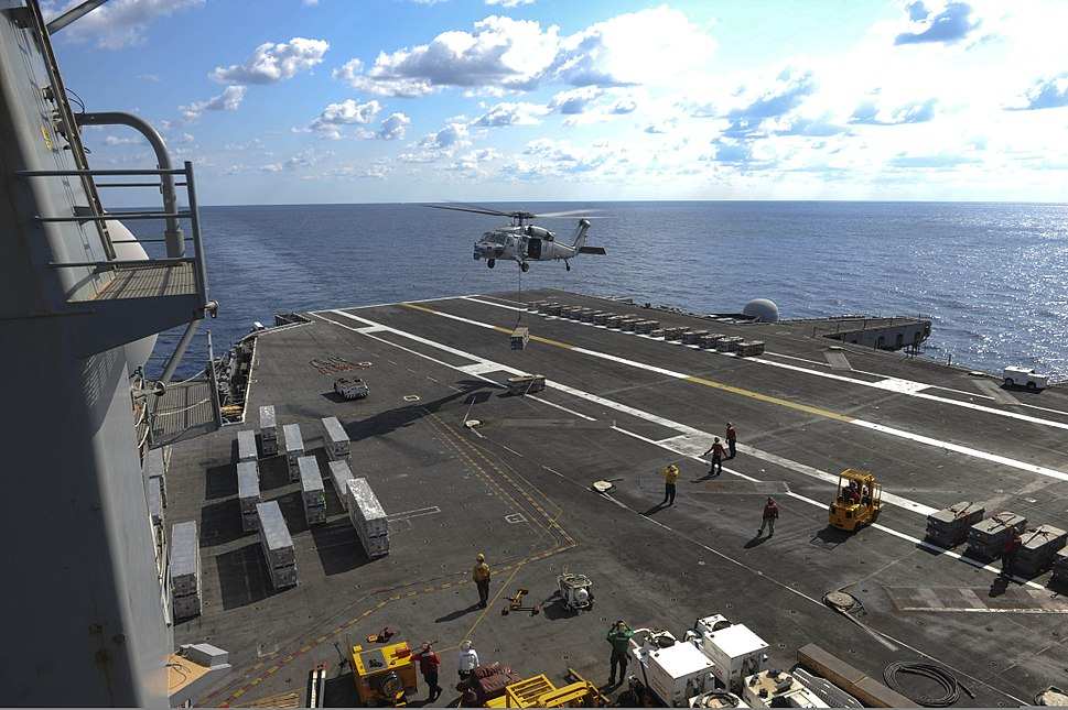 A U.S. Navy MH-60S Seahawk helicopter attached to Helicopter Sea Combat Squadron (HSC) 22 unloads ammunition onto the flight deck of the aircraft carrier USS Dwight D. Eisenhower (CVN 69) in the Atlantic Ocean 130806-N-FI568-009