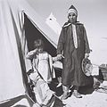 A YEMENITE WOMAN IN TRADITIONAL DRESS WITH HER CHILD AT THE EZRA UBITZARON QUARTER IN RISHON LEZION. עולים מתימן גרים באוהלים בשכונה חדשה בראשון לציוןD842-003.jpg