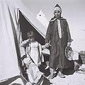 A YEMENITE WOMAN IN TRADITIONAL DRESS WITH HER CHILD AT THE EZRA UBITZARON QUARTER IN RISHON LEZION. עולים מתימן גרים באוהלים בשכונה חדשה בראשון לציוןD842-003.jpg
