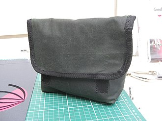 Waxed cotton - A pouch created using waxed cotton.