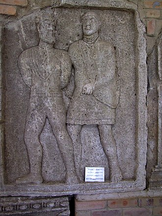 Battle of Adamclisi - A scene from the monument at Adamclisi, depicting a Roman soldier and a captive.
