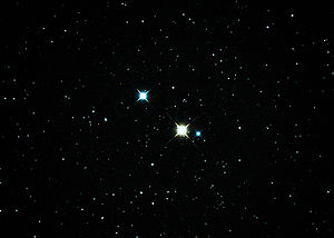 31 Cygni - 31 Cygni is the close pair.  The third star is 30 Cygni.