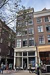 foto van Hoekhuis met gevel onder rechte lijst met triglyfen