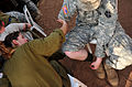 An Israeli Defense Forces soldier, left, applies mock wounds to a U.S. Soldier in preparation for an emergency response exercise during Austere Challenge 2012 in Beit Ezra, Israel 121022-F-QW942-031.jpg