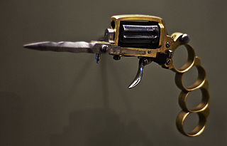 Apache revolver handgun which incorporates multiple other weapons, popularized by Les Apaches in France in the early 1900s
