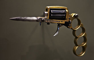 Brass knuckles - An Apache revolver, a weapon that combines brass knuckles with a firearm and a dagger – Curtius Museum, Liège, 2011