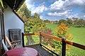 Aussicht vom Balkon Ferienhaus Schwarzwald mit grüner Wiese und Bach - panoramio.jpg