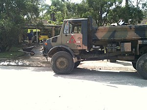 An Australian Army truck assisting with the cleanup of a flood affected suburb of Brisbane