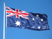 The Australian flag flying over the beach at N...
