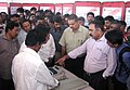 B.R. Babu, the District Magistrate & Collector and District Election Officer, Shri Soumitra Bandopadhaya and citizens watching EVM demonstration put up by election officials, at the voter awareness exhibition.jpg