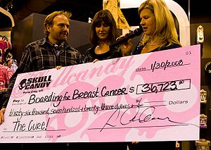 Skullcandy - Rick Alden donating to Boarding for Breast Cancer charity in 2007