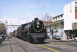 1977 in the United States - An excursion train pulled by a classic BC Rail steam locomotive visits Oakland, California in 1977