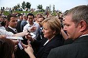 B Angela Merkel signing autographs 1.jpg