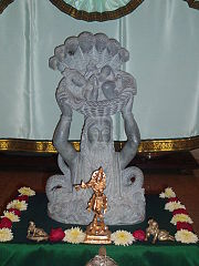 Baby Krishna being carried by Vasudeva