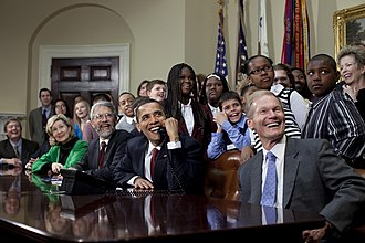STS-119 - President Obama, members of Congress, and schoolchildren speak with astronauts aboard the ISS.
