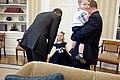 Barack Obama greets the daughter of a United States Secret Service agent, 2011.jpg