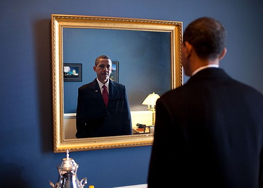 Barack Obama takes one last look in the mirror, before going out to take oath, Jan. 20, 2009