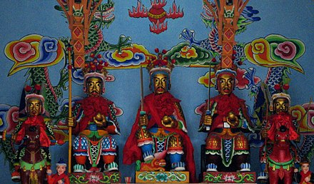 The pan-Chinese Sanxing (Three Star Gods) represented in Bai iconographic style at a Benzhu temple on Jinsuo Island, in Dali, Yunnan. Benzhu Sanxing, Dali, Yunnan.jpg