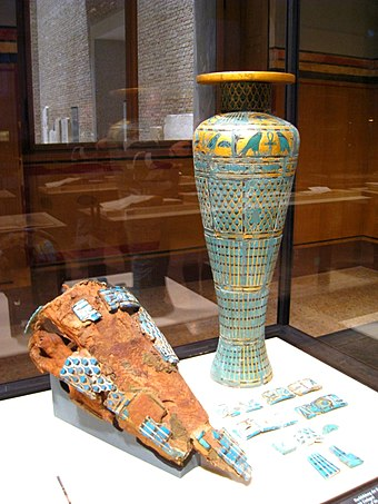 Reconstruction of a ritual vase made of sycamore wood with faience and gold inlays showing Neferirkare's cartouche and found in his mortuary temple. Now in the Egyptian Museum of Berlin. Berlin 122009 022.jpg