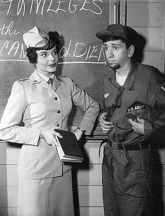 "The Many Loves of Dobie Gillis - Maynard was not prepared to give up his beard after entering the army. Bob Denver and Kay Elhardt are featured in this still from the Dobie Gillis episode ""The Ballad of Maynard's Beard"", originally aired April 18, 1961."