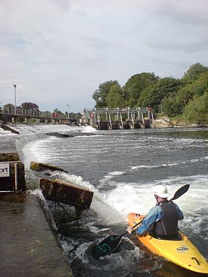 Boulter's Lock - Kayaker by the weir flume, during the summer season