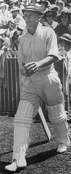 Bradman walking out to bat in the third Test against England at the Melbourne Cricket Ground in 1937. His 270 runs won the match for Australia and has been rated the greatest innings of all time.