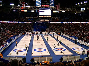 Curling is a game played on ice with granite stones; in this picture, four curling sheets are shown.