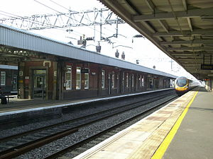 Nuneaton railway station - A Virgin Trains Pendolino arrives at the platform.