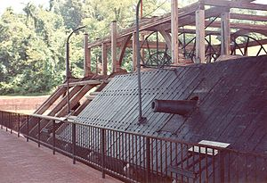 USS Cairo - One of the cannons on the side of the Cairo. The framework for the paddlewheels is in the background.