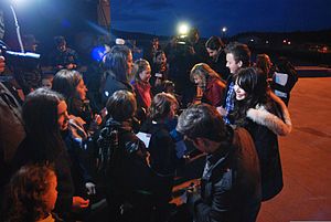 "Cast members of the Nickelodeon TV program ""iCarly"" sign autographs for fans before touring the attack submarine USS Hartford (SSN 768) Jan 120111-N-OV358-120.jpg"