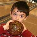 Child with duckpin bowling ball.jpg