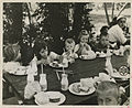 Children eating lunch at a country camp, circa 1950 (7680417512).jpg