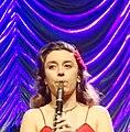 Chloe Feoranza playing the clarinet with Postmodern Jukebox live @ FZW Dortmund, March 18, 2018 (40853935842).jpg
