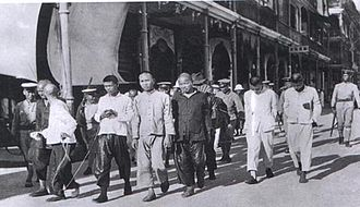 Nationalist government - KMT troops rounding up Communist prisoners.
