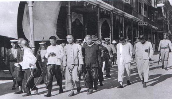 KMT troops rounding up Communist prisoners for execution: 1927. Communist purge.jpg