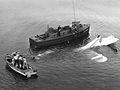 Crew of crashed J2F-6 is rescued off Salem 1945.jpg