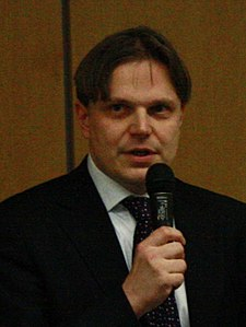 Cropped portrait of Pavel Kohout, Czech Economist at conference at MZLU in Brno, Brno-City District.jpg