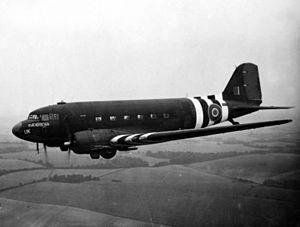 "No. 233 Squadron RAF - Douglas Dakota Mark III, FZ692 '5T-UK' ""Kwicherbichen"", of No. 233 Squadron RAF based at RAF Blakehill Farm. The aircraft is returning to the United Kingdom with wounded from the Normandy battlefront. Invasion stripes are painted on the side of the aircraft."